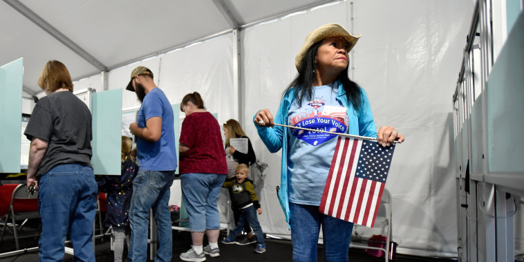 Election worker Leah Barney watches over voters as they cast their ballots on Nov. 6, 2018 in Las Vegas.