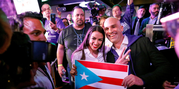 Image: Democratic congressional candidate Alexandria Ocasio-Cortez greets supporters at her midterm election night party in New York City