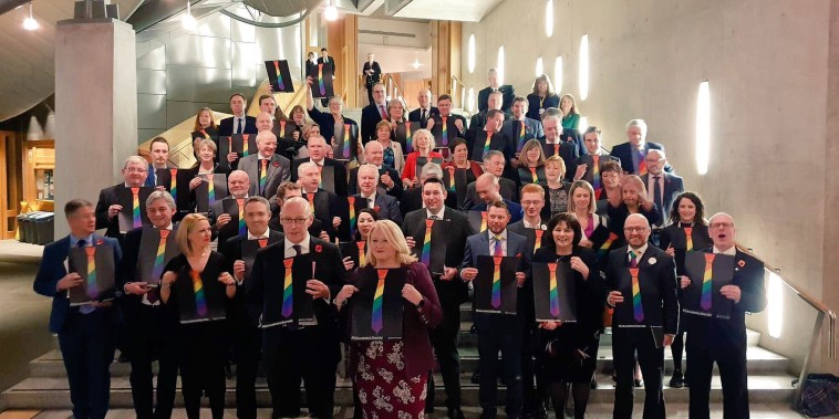 Members of Scottish Parliament pose with the symbol of the TIE campaign after announcing their LGBTI curriculum on Nov. 8, 2018.