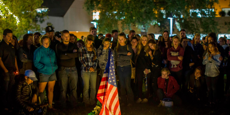 People gather during a vigil for the victims of a shooting in Thousand Oaks, California