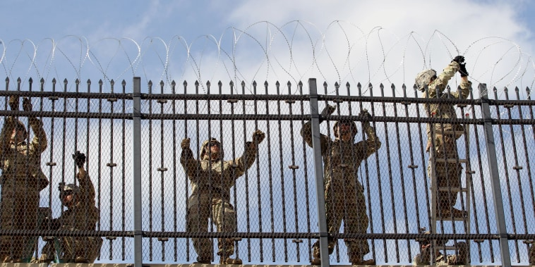 Image: FILE PHOTO: FILE PHOTO: U.S. Army soldiers install a razor wire fence near the U.S-Mexico border in McAllen