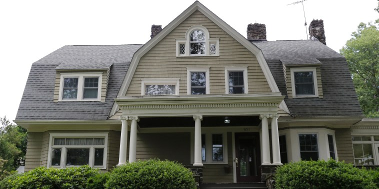 """The home of Derek and Maria Broaddus in Westfield, New Jersey on June 25, 2015. The couple wants to demolish the house after they claim they were stalked by an anonymous creepy-letter writer known as """"The Watcher""""."""