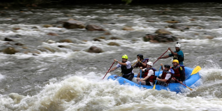 Image: A group of the press and government representatives practice rafting guided by ex-FARC rebels in Miravalle