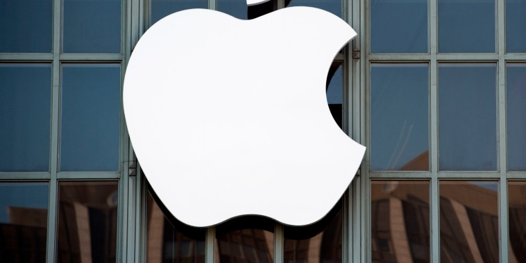 Image: The Apple logo is seen on the outside of Bill Graham Civic Auditorium before the start of an event in San Francisco