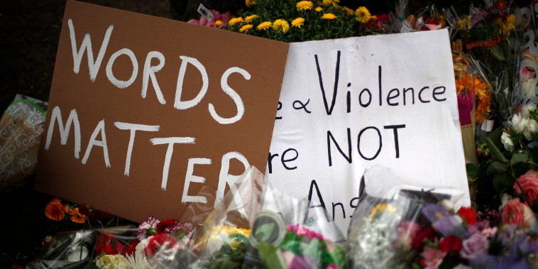 Flowers and signs at a memorial for the 11 people who were killed in a shooting at the Tree of Life Synagogue in Pittsburgh on Oct. 27, 2018.
