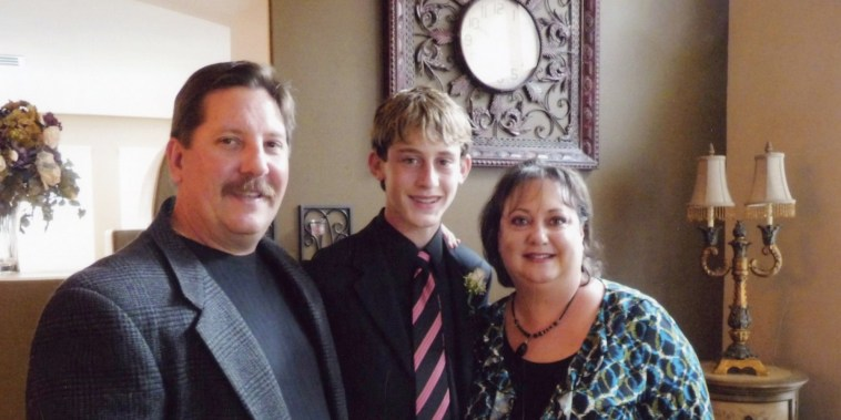 Image: Sgt Ron Helus with his wife Karen and son Jordan