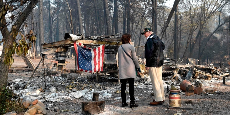 Image: President Donald Trump views damage from wildfires in Paradise, California on Nov. 17, 2018.