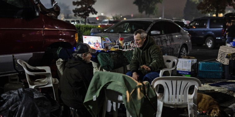 Residents of Paradise, California have been camping in tents and sleeping in their cars in a Walmart parking lot after escaping the fires that tore through their town, on Nov. 15, 2018.