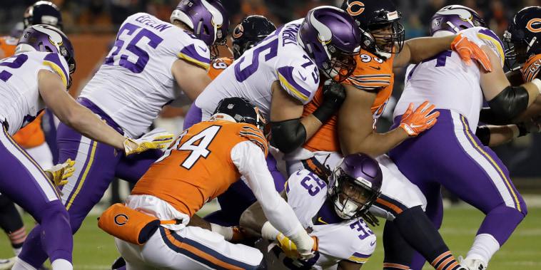 Chicago Bears linebacker Leonard Floyd (94) tackles Minnesota Vikings running back Dalvin Cook (33) during the first half of an NFL football game