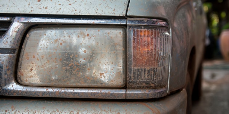 Dirty Headlights car covered in mud.