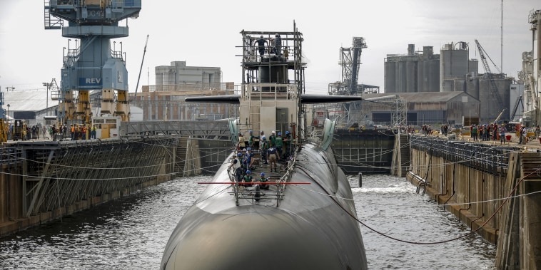 Image: A submarine in one of the Norfolk Naval Shipyard's dry docks, which can be pumped dry to allow repairs on a vessel.