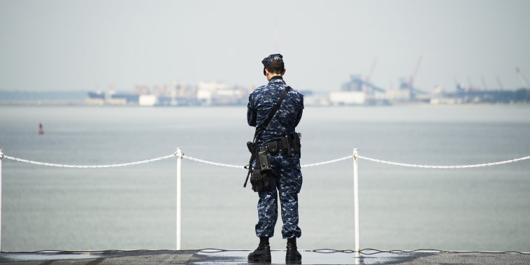 Image: A sailor stands security watch aboard USS Harry S Truman at Naval Station Norfolk in Norfolk, Virginia