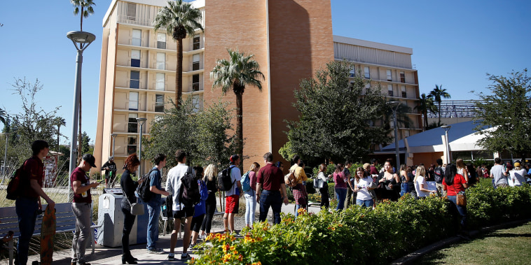 People line up to vote at the ASU Palo Verde West polling station during the midterm elections in Tempe