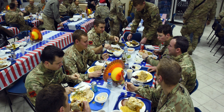 U.S. soldiers eat a Thanksgiving Day meal in Kabul, Afghanistan, in 2014.