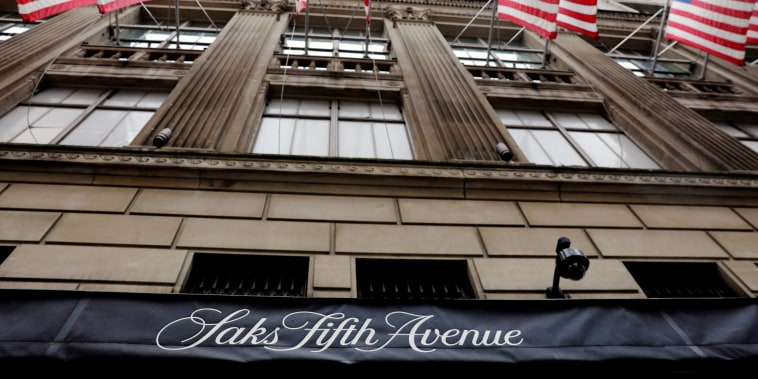 Image: U.S. flags fly outside of Saks Fifth Avenue in New York
