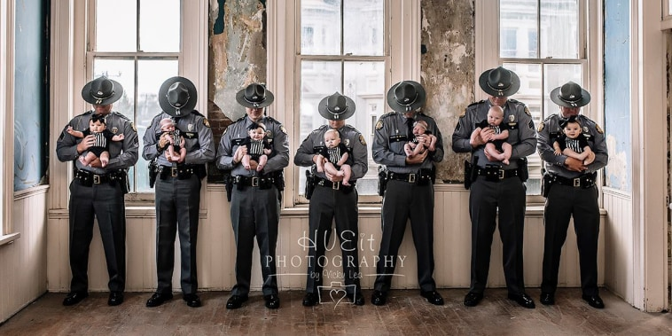 Seven Kentucky State Police officers pose with their babies.