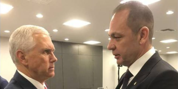 Venezuelan media mogul Raul Gorrin shakes hands with Vice President Mike Pence in an undated photo.