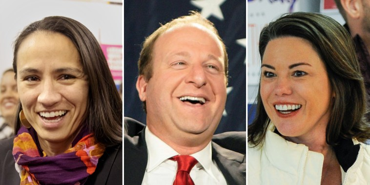 Sharice Davids, Jared Polis and Angie Craig