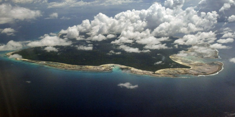Image: Clouds hang over the North Sentinel Island, in India's southeastern Andaman and Nicobar Islands.