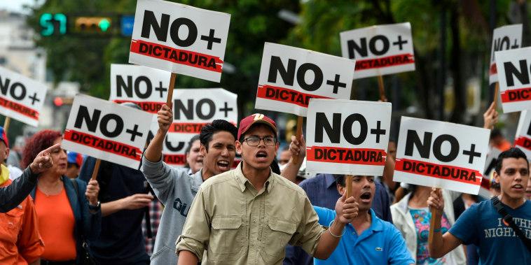 Image: Opposition demonstrators protest against Venezuelan President Nicolas Maduro in Caracas on Jan. 30, 2019.