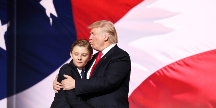 Image: Donald Trump embraces his son, Barron, at the Republican National Convention in Ohio on July 21, 2016.