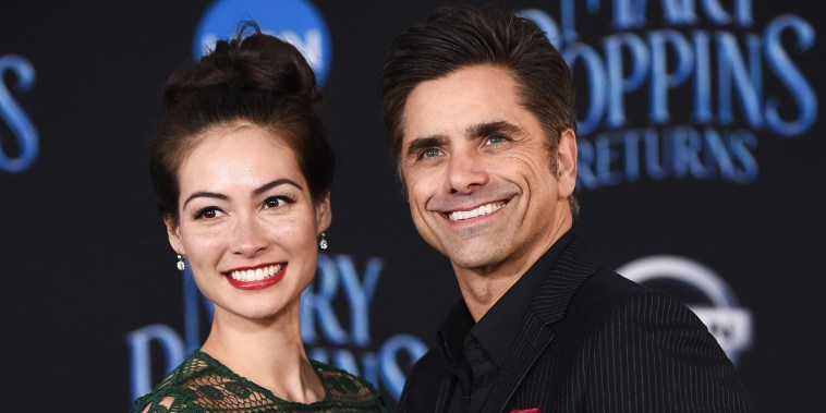 John Stamos and wife Caitlin McHugh