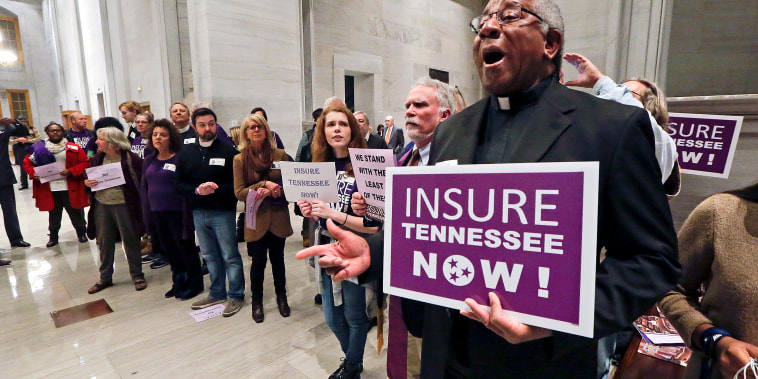 Protesters calling for the passage of Gov. Bill Haslam's Medicaid expansion proposal demonstrate outside the House chamber before Haslam delivers his State of the State address Feb. 1, 2016, in Nashville, Tennessee.