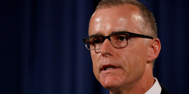 Image: Acting FBI Director Andrew McCabe talks during a news conference at the Justice Department in Washington