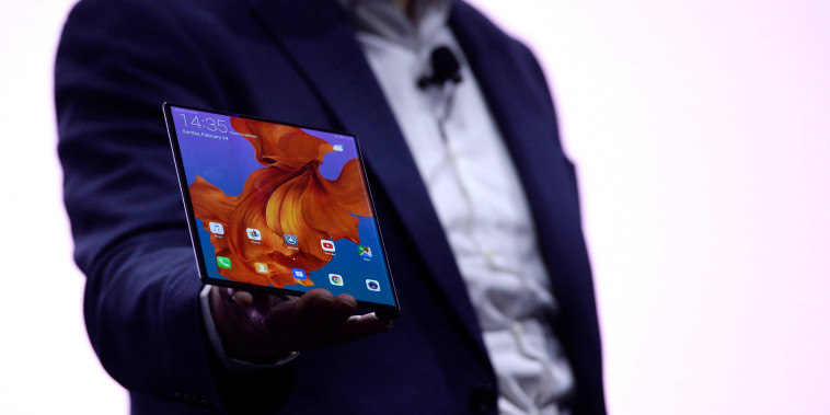 Image: Richard Yu, the CEO of Huawei's consumer products division, holds the Mate X foldable smartphone at the Mobile World Congress in Barcelona on Feb. 24, 2019.