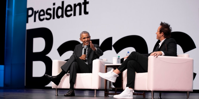 Image: Former President Barack Obama speaks with Qualtrics co-founder and CEO Ryan Smith during the company's annual user summit at the Salt Palace Convention Center on March 6, 2019.