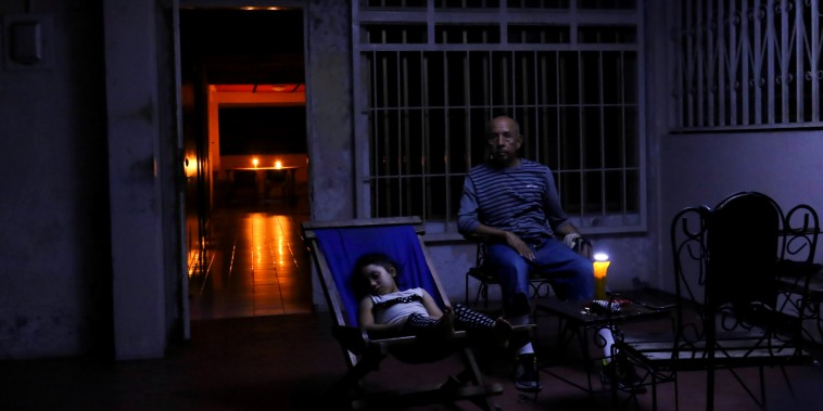 Image: People rest at their house during a blackout in Puerto Ordaz, Venezuela, on March 9, 2019.