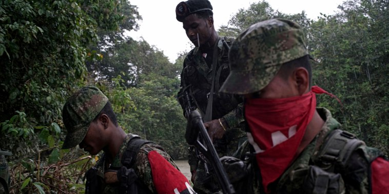 Image: Rebels of Colombia's National Liberation Army (ELN) patrol the river in the northwestern jungles of Colombia on Aug. 30, 2017.