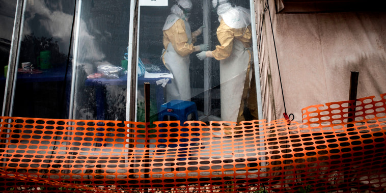 """Image: Health workers are seen inside the \""""red zone\"""" of an Ebola treatment center in Butembo in the Democratic Republic of Congo on March 9, 2019."""