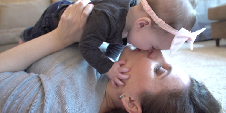 Mom Sandra Chance feeds her baby girl Charlotte a combination of pumped breast milk and formula.
