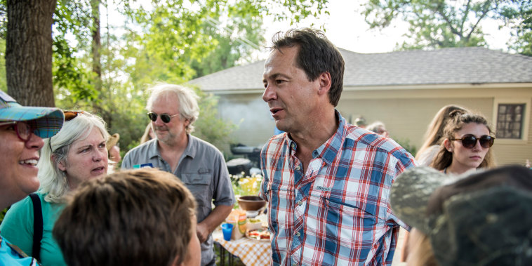 Image: Montana Governor Steve Bullock campaigns at a gathering of Democrats in Livingston on July 2, 2016.
