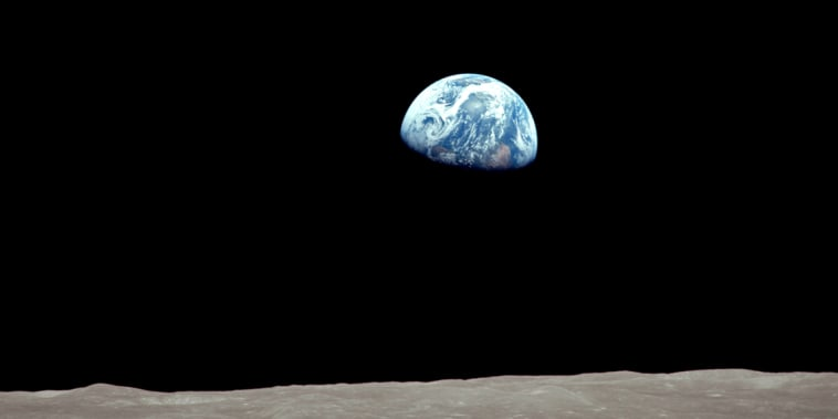 On December 24, 1968 during the Apollo 8 mission, the Earth rose into view over the Moon's limb.