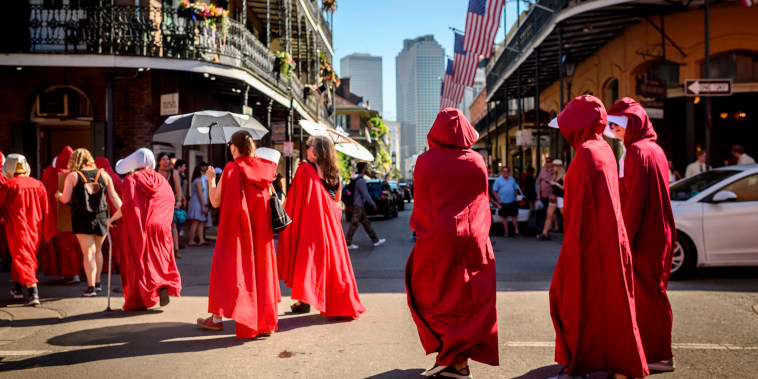 Image: Handsmaid themed protesters march down the French Quarter of New Orleans, Louisiana