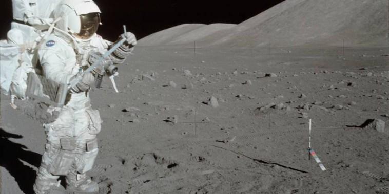 NASA astronaut Harrison Schmitt collects lunar rake samples during the Apollo 17 misssion at the Taurus-Littrow landing site on Dec. 11, 1972.