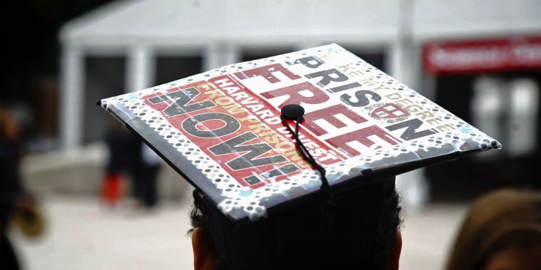"""Anneke Dunbar-Gronke wears a graduation cap outfitted with a sign that reads \""""Make my degree prison free Harvard divest from prisons now!\"""""""