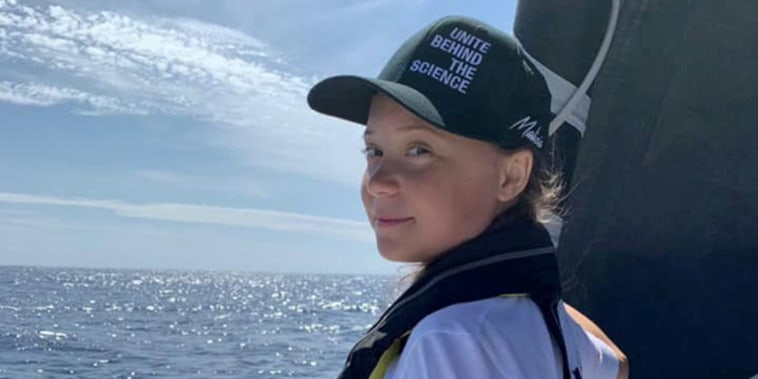 Image: Swedish 16-year-old activist Greta Thunberg stands on the bow of the Mazilia II racing yacht as she completes half of her trans-Atlantic crossing at sea