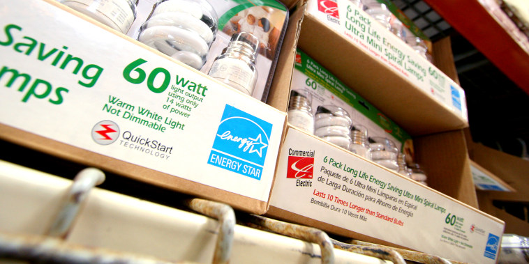 Rows of energy-efficient compact fluorescent light bulbs, marked with the blue energy star symbol, await shoppers at a Home Depot store Tuesday, Oct. 3, 2006, in Orlando, Fla.