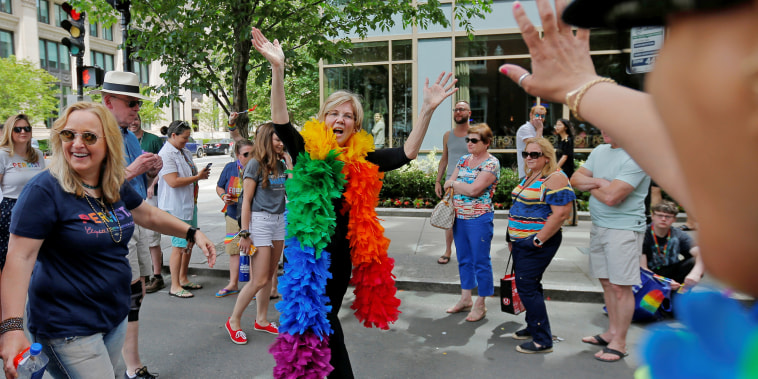 U.S. Senator Elizabeth Warren and musician Melissa Etheridge march in Boston's 48th Pride Parade in Boston