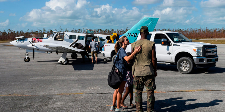 Image: Volunteer Dena Wood from Austin, Texas hugs her friend Fritz after she arrived with relief supplies in the aftermath of Hurricane Dorian at the airport in Treasure Cay on Abaco island, Bahamas