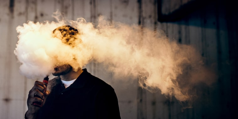 Image: Man Using An Electric Cigarette and or Vape