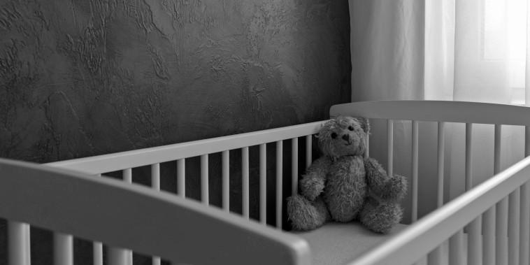 Teddy bear in a crib