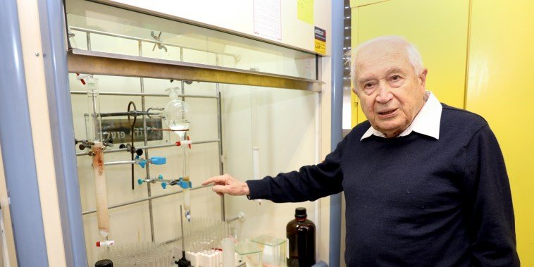 Raphael Mechoulam explaining steps of the process at his Hebrew University lab in Israel.