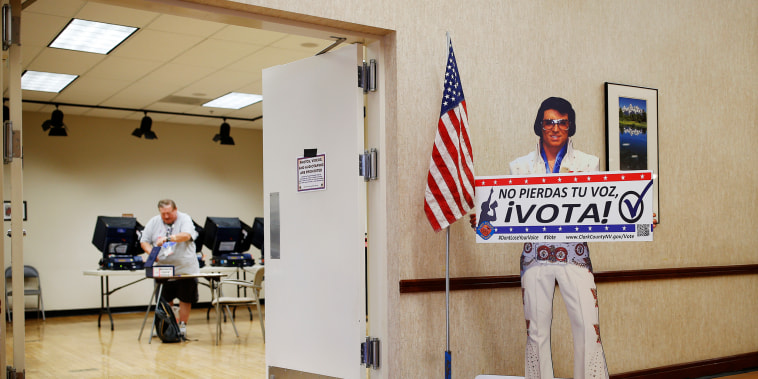 A sign with an Elvis impersonator reminds people to vote at an early primary election polling site in Las Vegas on May 31, 2016.