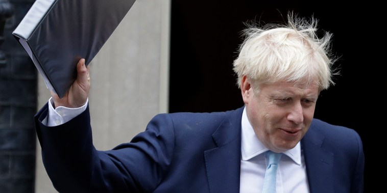 Britain's Prime Minister Boris Johnson leaves Downing Street to attend Parliament in London.