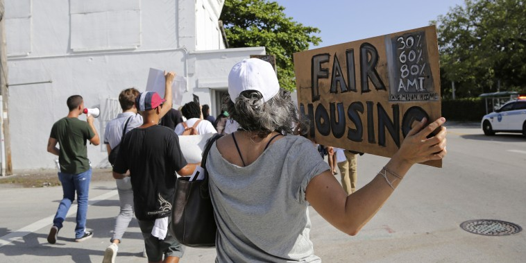 Activists march against the proposed Magic City Innovation District in the Little Haiti neighborhood of Miami on June 20, 2019. Critics say the proposed 17-acre mixed-use development would exacerbate gentrification and force out longtime residents of the neighborhood.