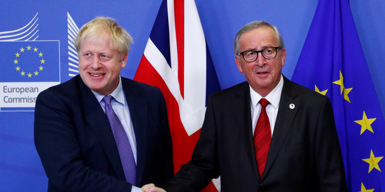 Image: European Commission President Jean-Claude Juncker and Britain's Prime Minister Boris Johnson shake hands during a news conference after agreeing on the Brexit deal